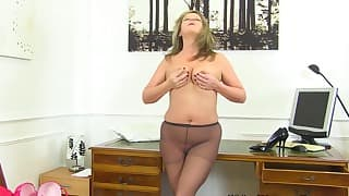 Sensual mature in high heels shows tits