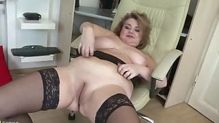 Good-looking mom in stockings gets nude