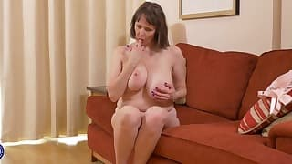 Busty mom solo action on the sofa