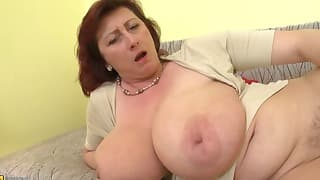 Big breast mom licks her hard nipples