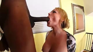 White model sucks a gigantic black dick
