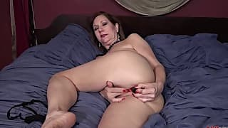 Big-boobed mom is getting naked